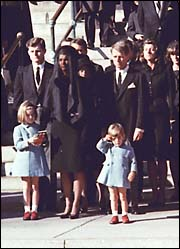 John F. Kennedy Jr. salutes at funeral of father